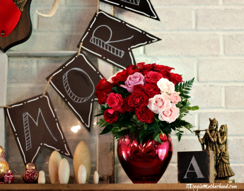 The Easy DIY Valentine Mantle Sign is highlighted by flowers from FTD