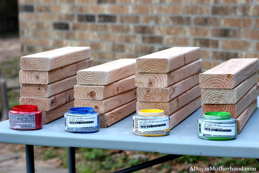 Bright colors make the kids want to play the DIY Outdoor Stacking Game