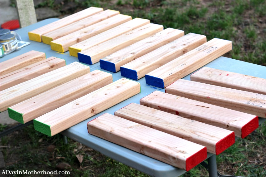 Paint the ends to make the DIY Outdoor Stacking Game colorful
