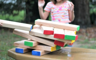 My DIY Outdoor Jenga Game is easily modified for kids!