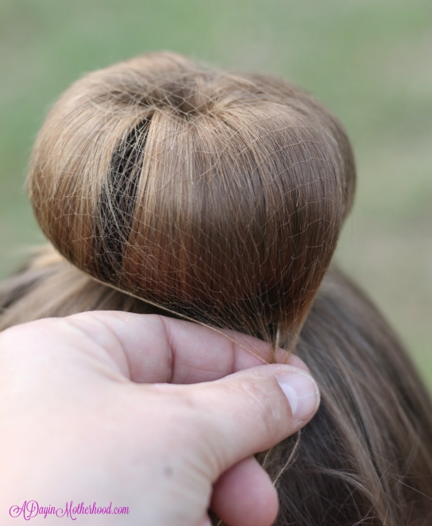 Gently twist the hairnet around the Easy Princess Updo