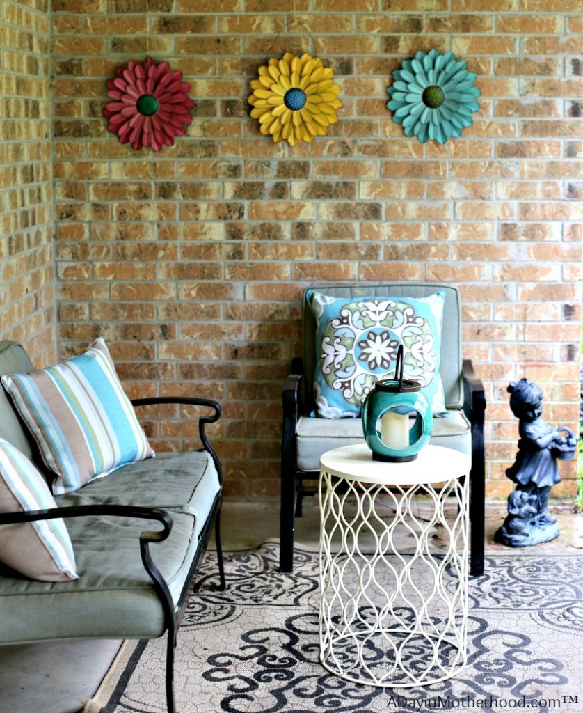 Add a little color is a tip for How to Dress up Your Patio Furniture for Spring