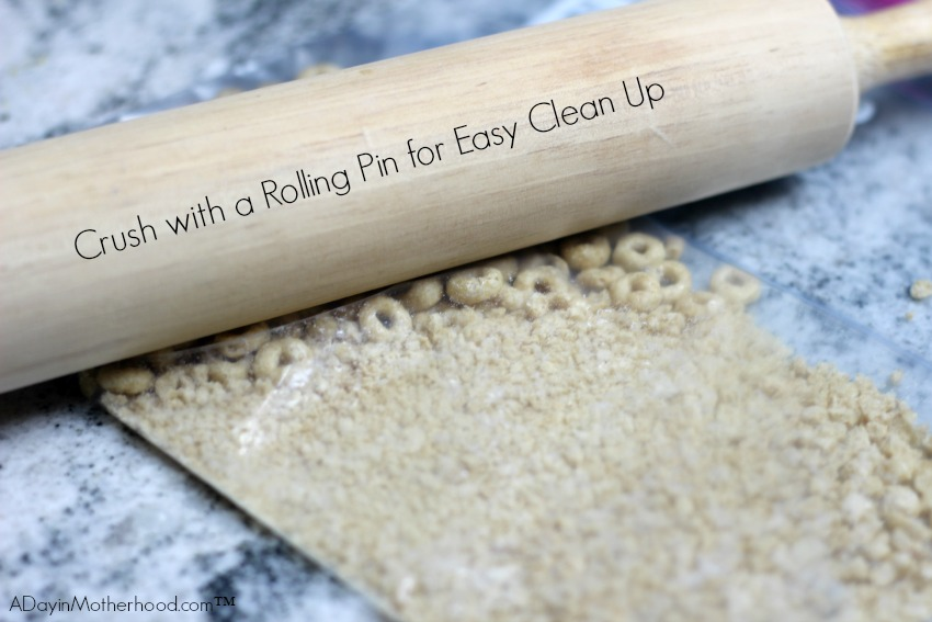 Using a rolling pin to ground the Honey Nut Cheerios for the Chocolate Peanut Butter Cheerios Cups is easy and has minimal clean up!