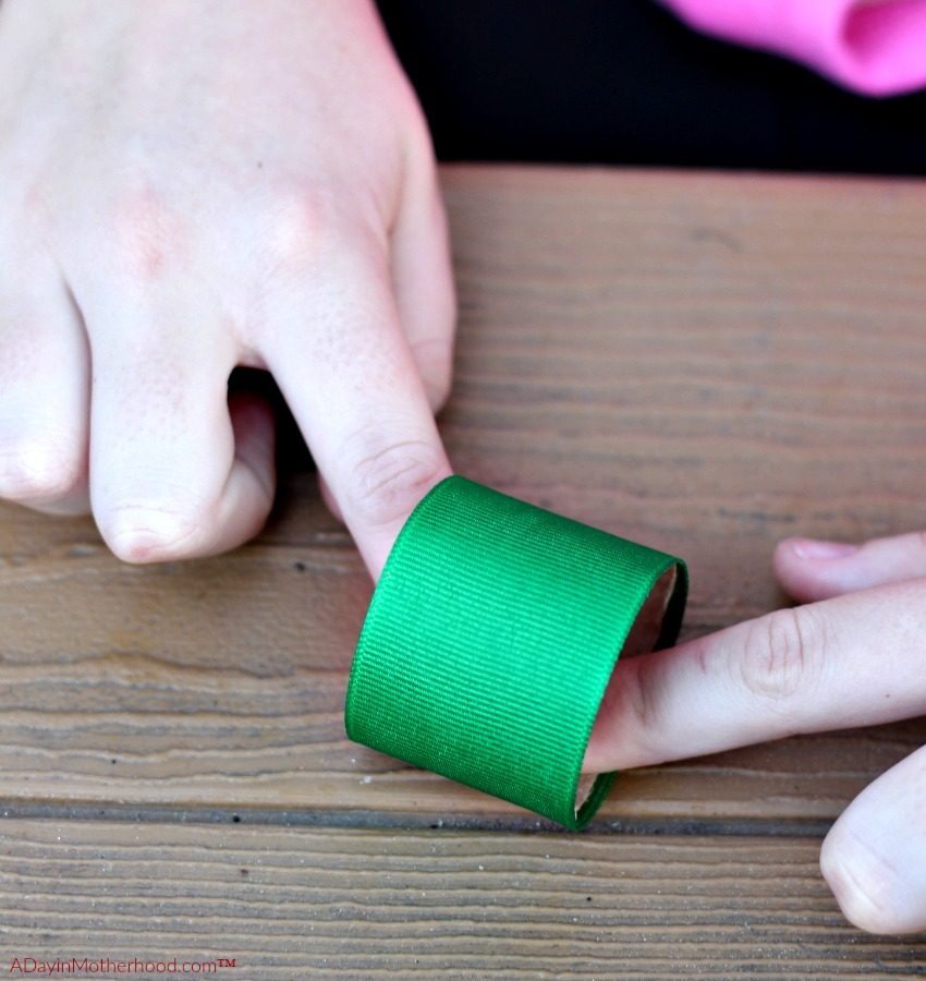 Wrap the glued ribbon around the tube for your DIY Holiday Napkin Rings