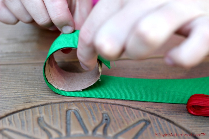 Measure your ribbon for the DIY Holiday Napkin Rings