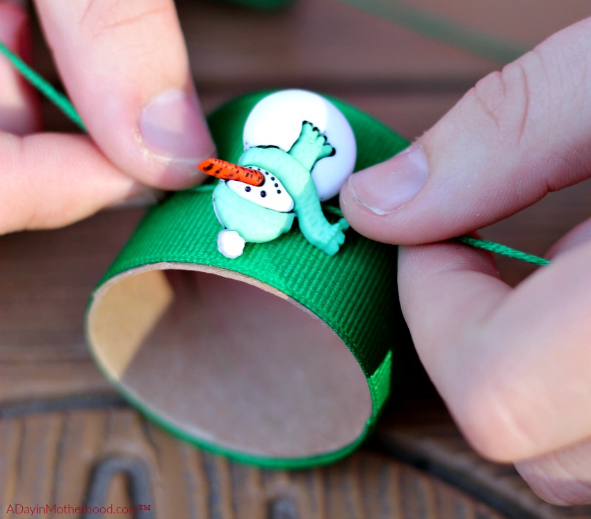Tie the bauble to the DIY Holiday Napkin Rings