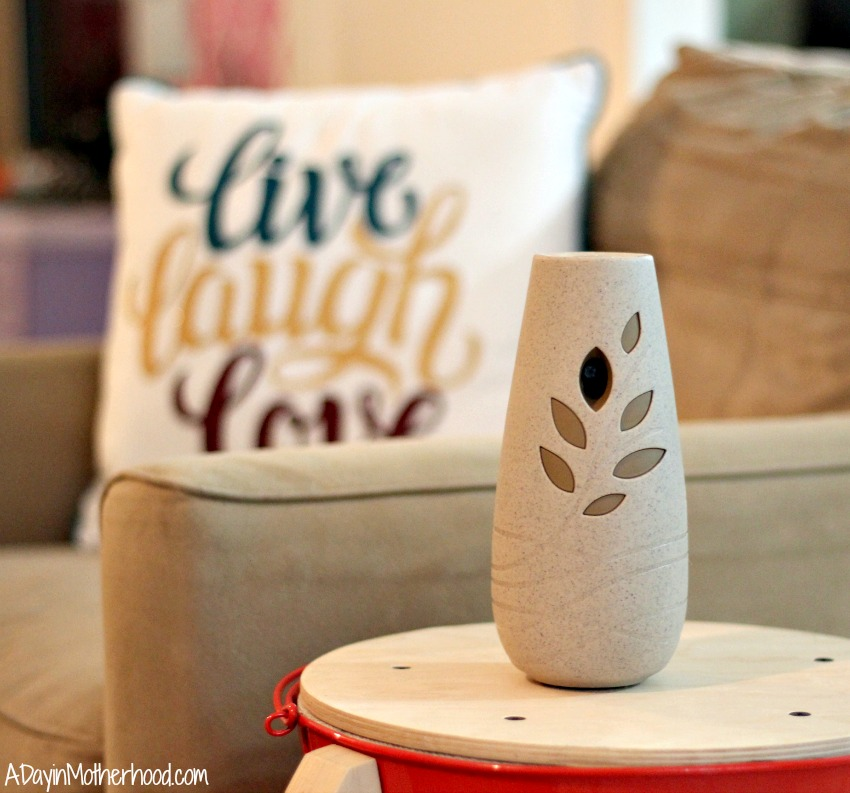 The Glade Happy Glow auto sprayer mixes into the decor of any home