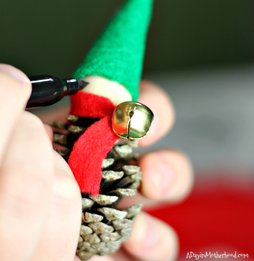 Secure the bell for the Pinecone Elf Ornaments