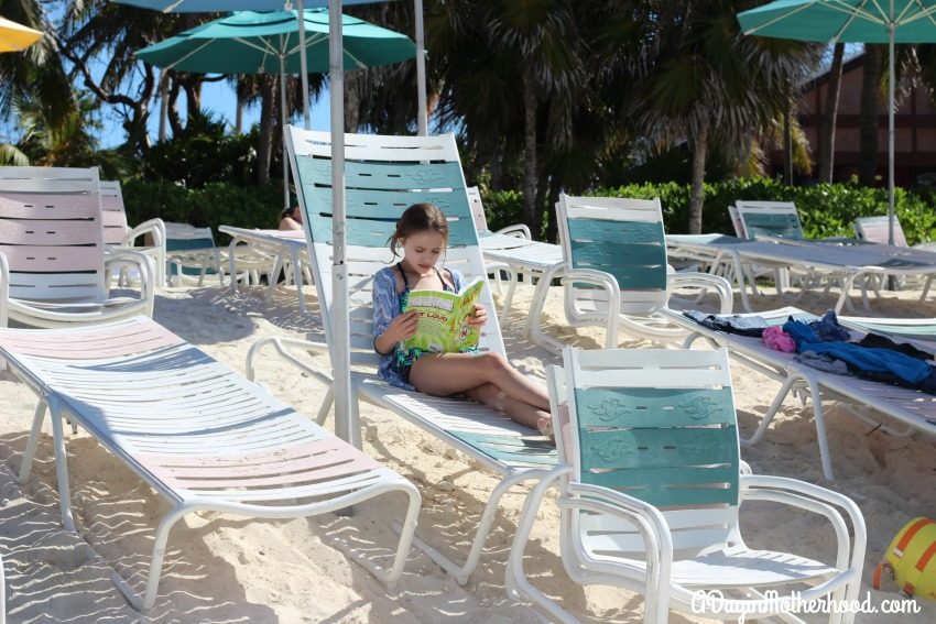 Relax on the beach with a book on Castaway Cay