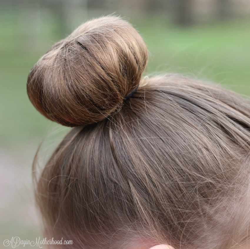 The hairnet keeps the shorter hair for the Easy Princess Updo contianed