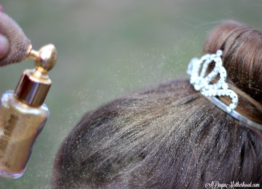 Spray glitter to add shine to the Easy Princess Updo for Kids