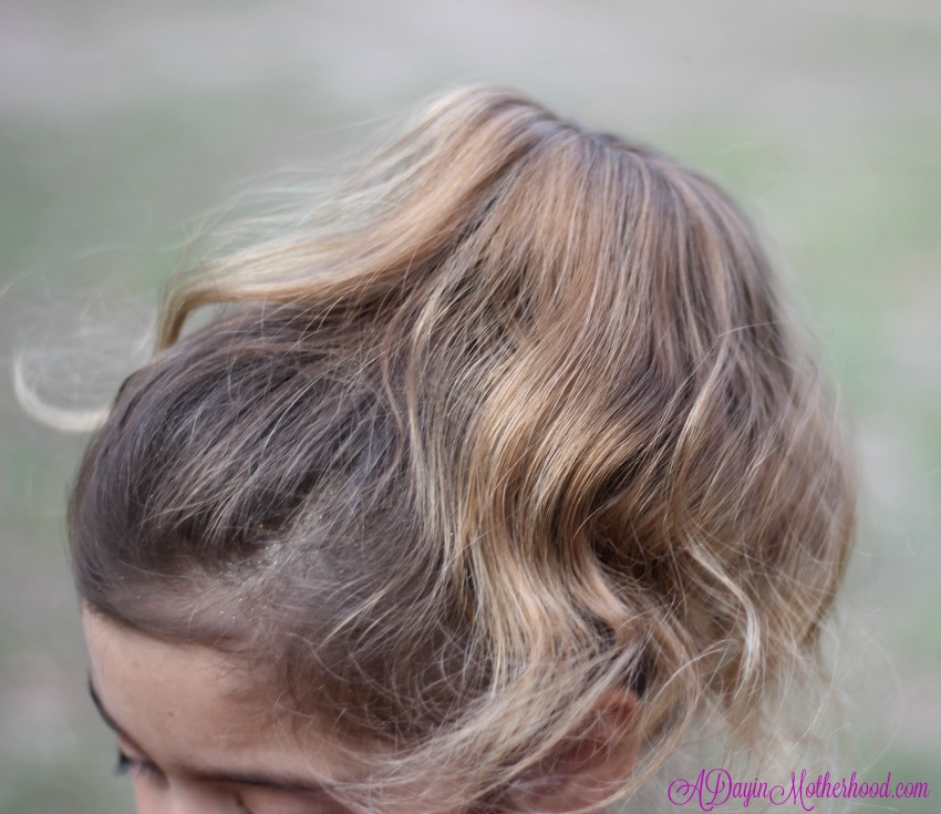 Comb the hair over for the Easy Princess Updo for Kids