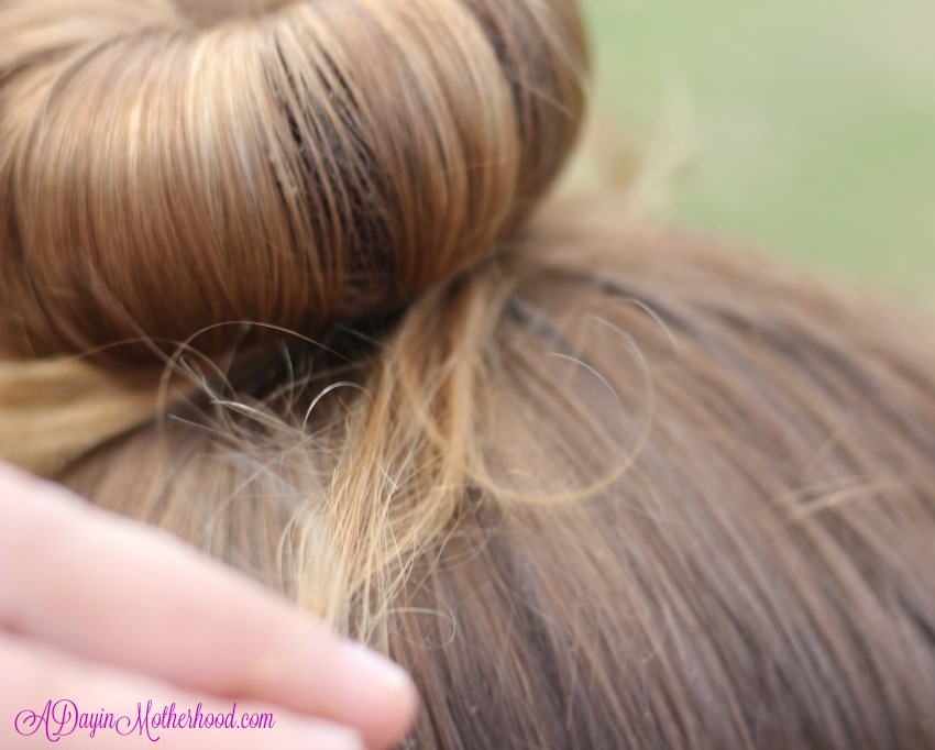 Gently pull the hair around the bun for the Easy Princess Updo for Kids