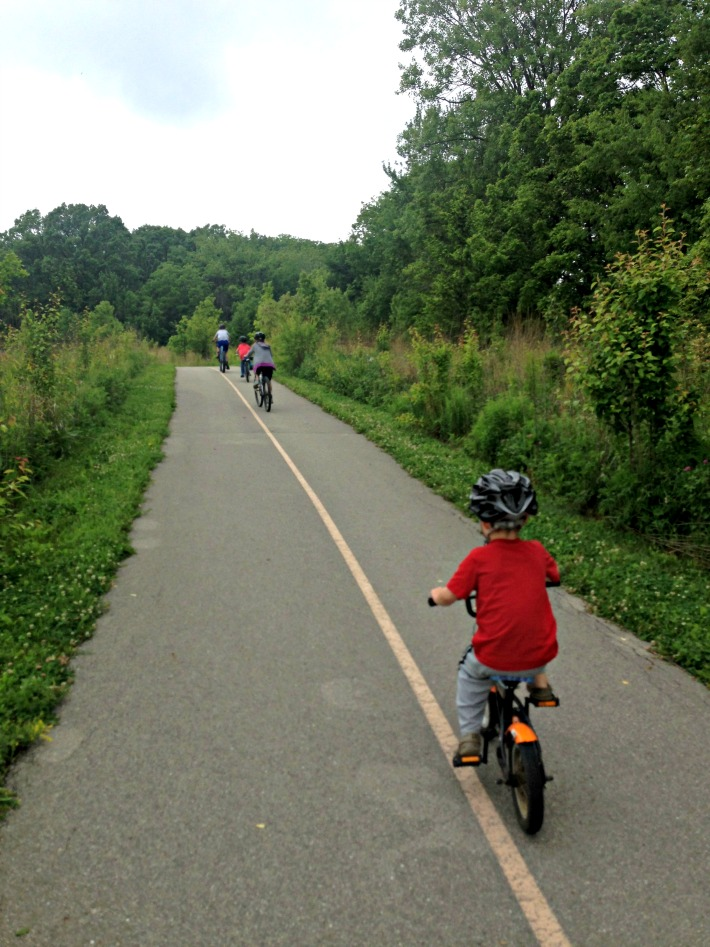 Take a family bike ride to keep your summer fitness routine.