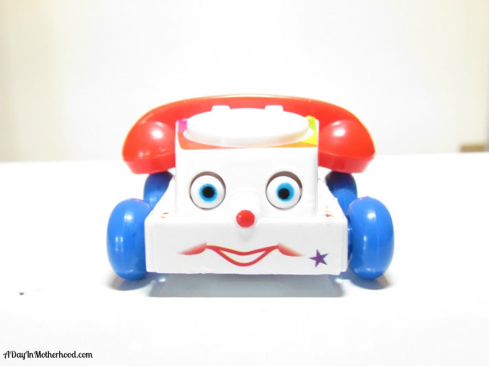World's Smallest Fisher-Price Chatter Telephone from Super Impulse. ad