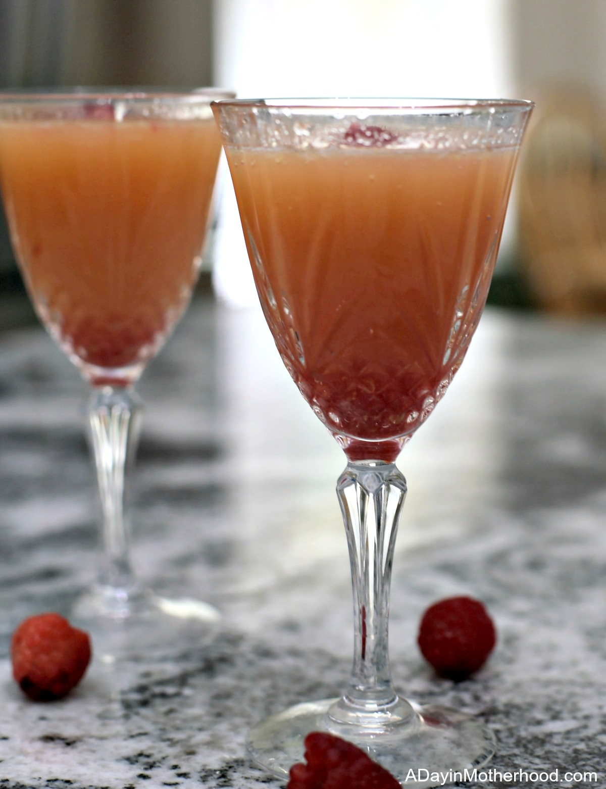 Raspberry Mimosa Mocktail Recipe and sip it