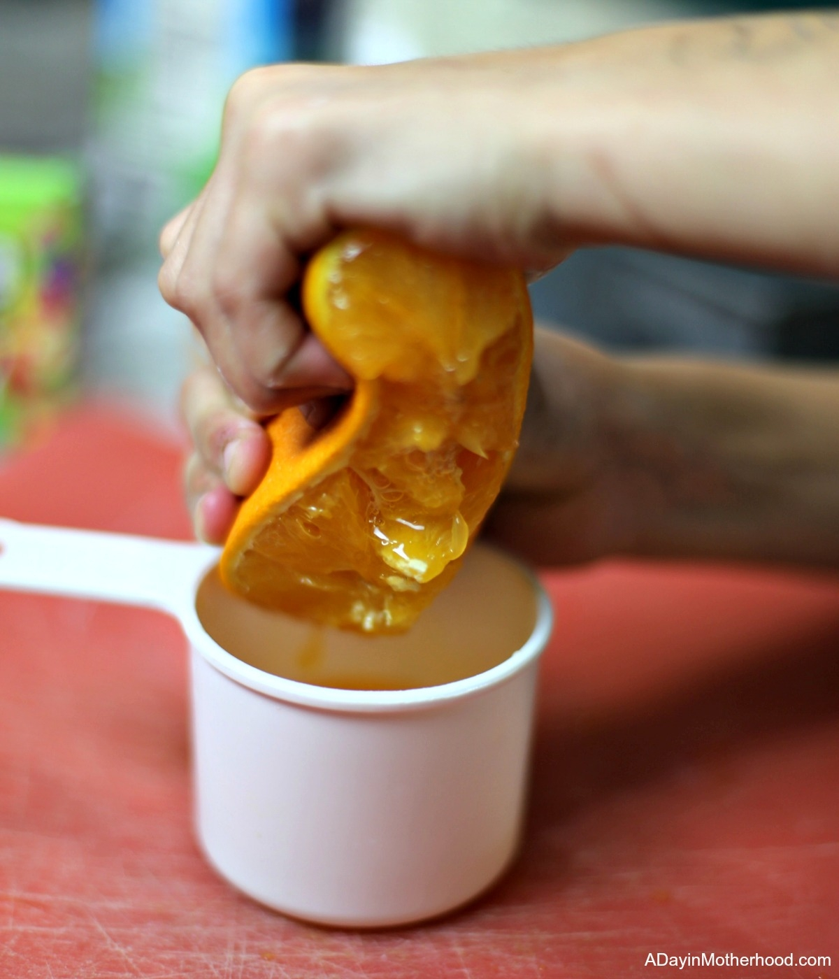 How to Make No Churn Orange Ice Cream with a Mike & Ike Sour Twist and squeeze