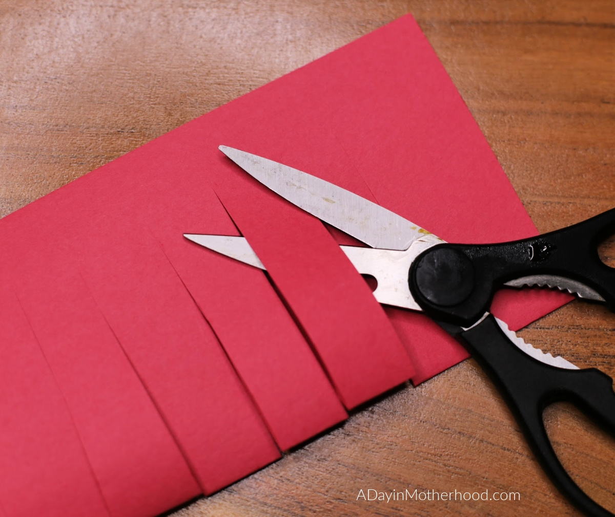 Celebrating Chinese New Year: cut the paper