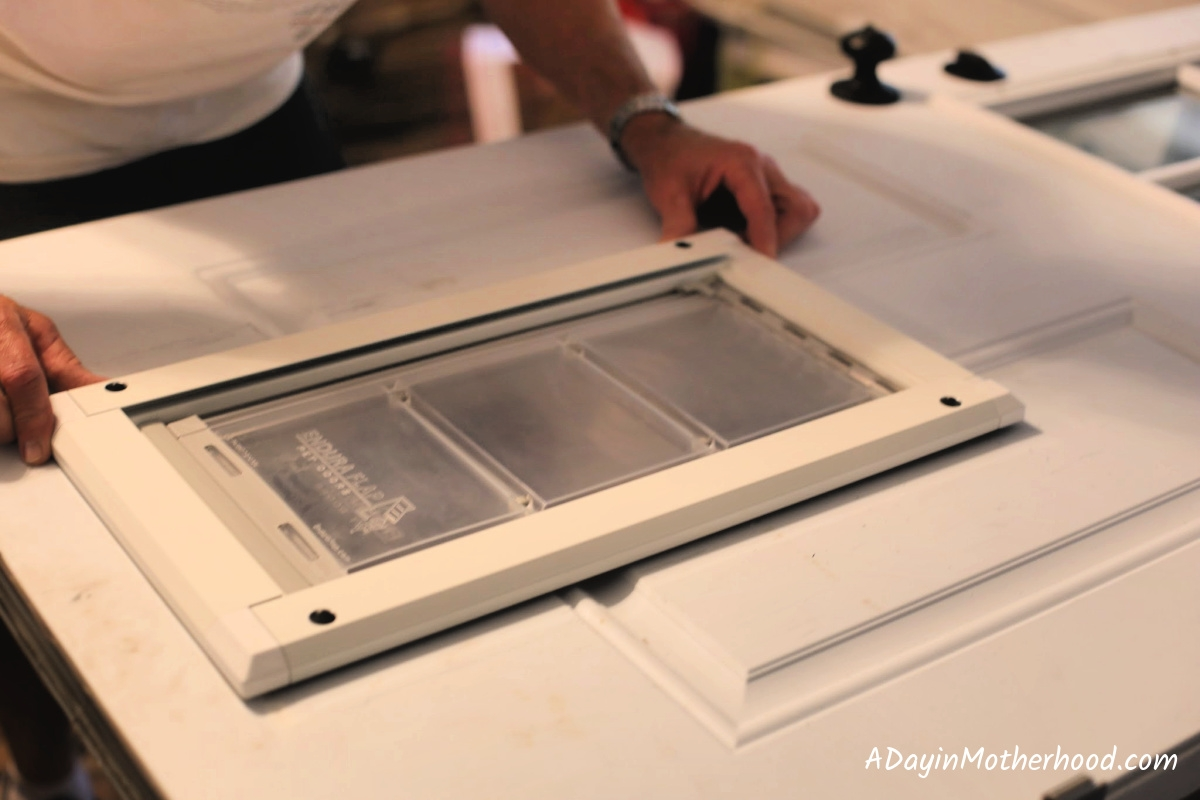 Place the door in the metal frame to install the Endura Flap