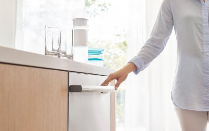 Bosch 800 Series Dishwasher Features - photo of woman opening dishwasher on adayinmotherhood.com
