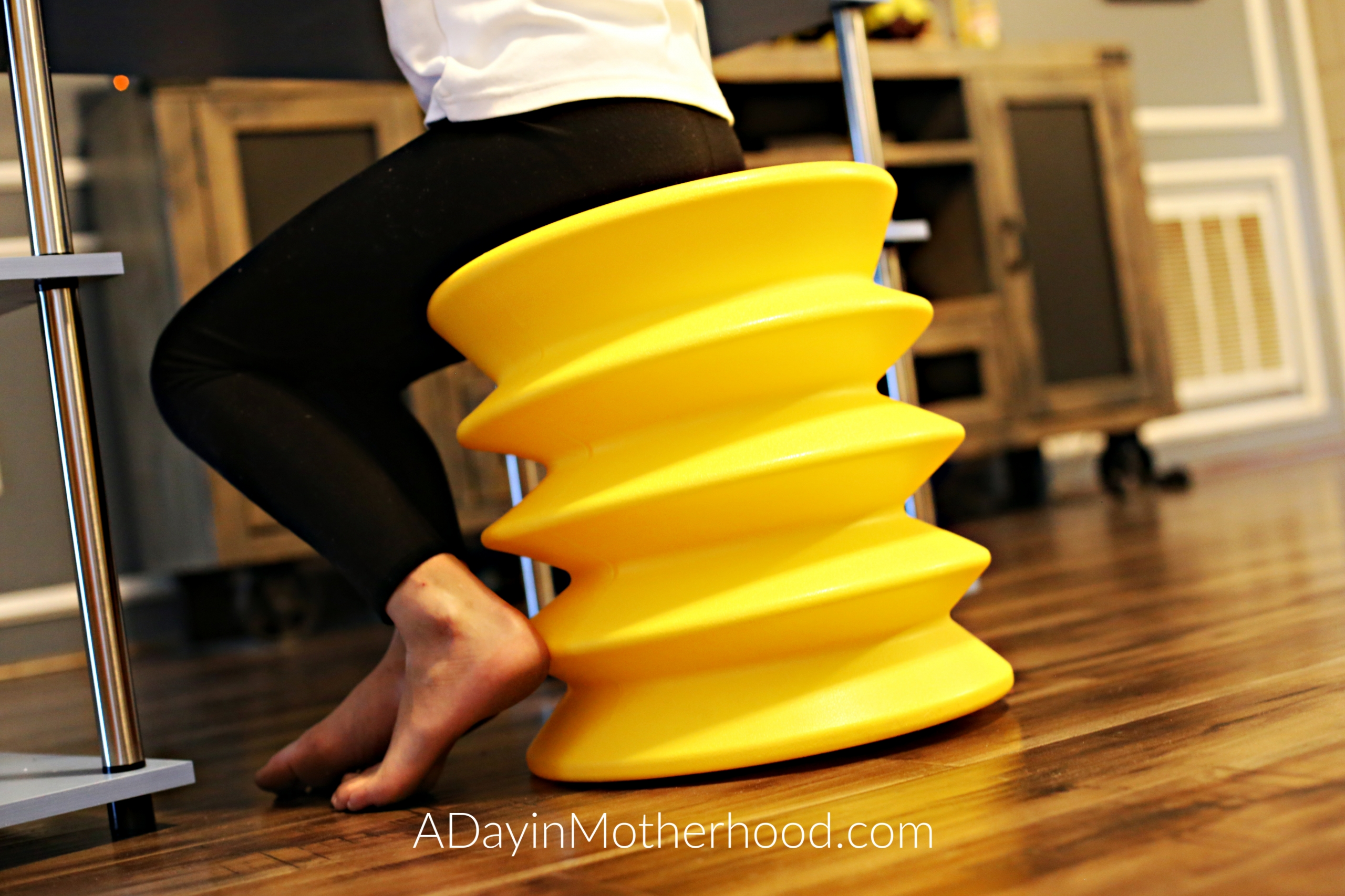 ErgoErgo and Tossits to help me get moving in the New Year-Close up of yellow stool on adayinmotherhood.com