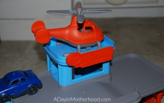 Best Toys for the New Year-photo of helicopter on top of toy garage on ADayinMotherhood.com
