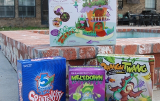 PlayMonster Survival Guide is Fun for the Whole Family-a photo of four games on ADayinMotherhood.com