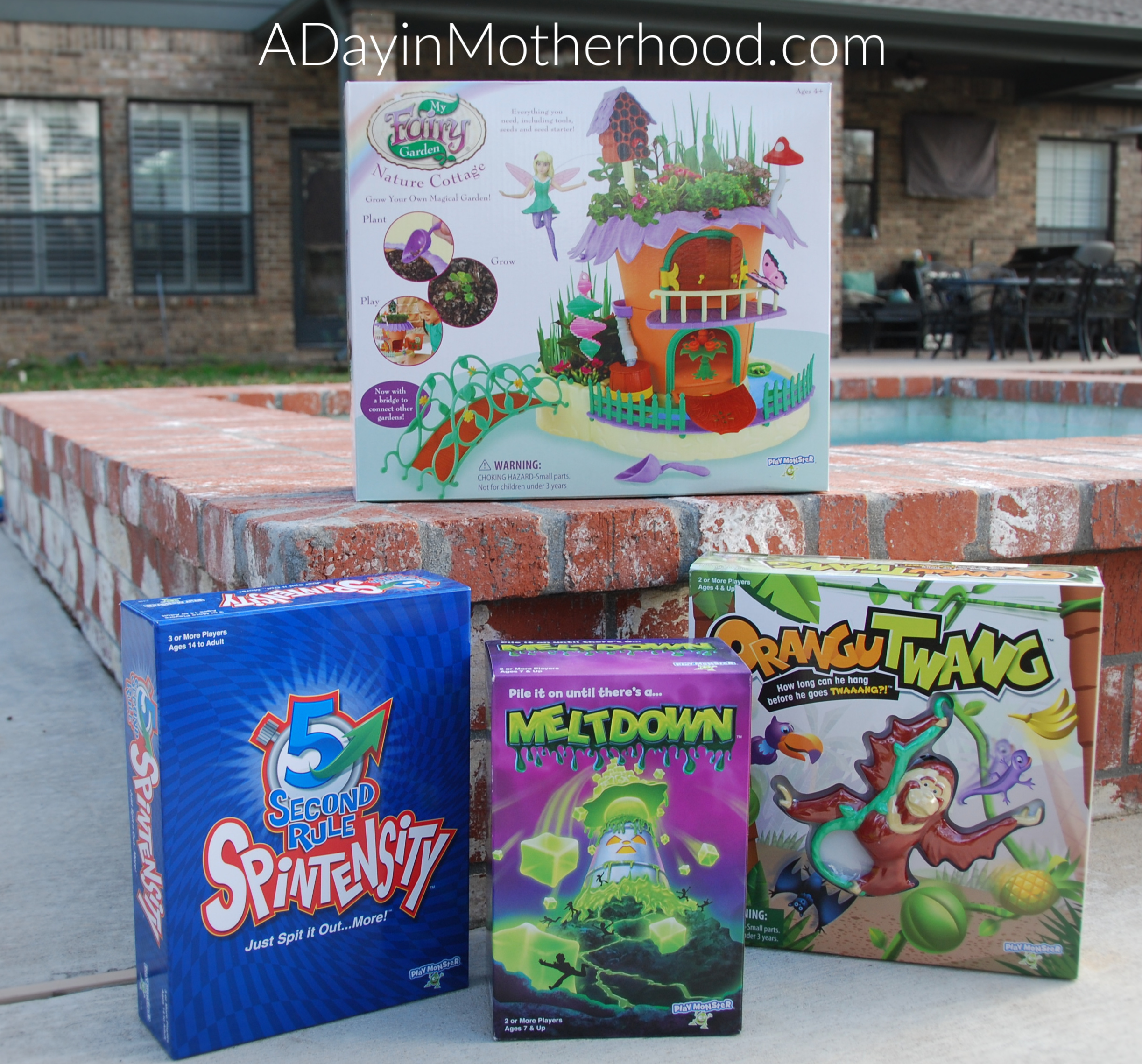 PlayMonster Survival Guide is Fun for the Whole Family-photo of four games on ADayinMotherhood.com