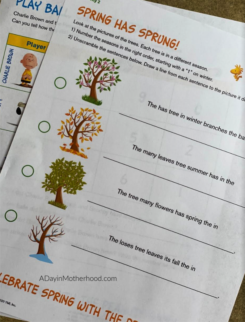 Snoopy + Free Homeschooling Ideas = A Happy Mom and Happy Kids - shot of paperwork from homeschooling with the peanuts on adayinmotherhood.com